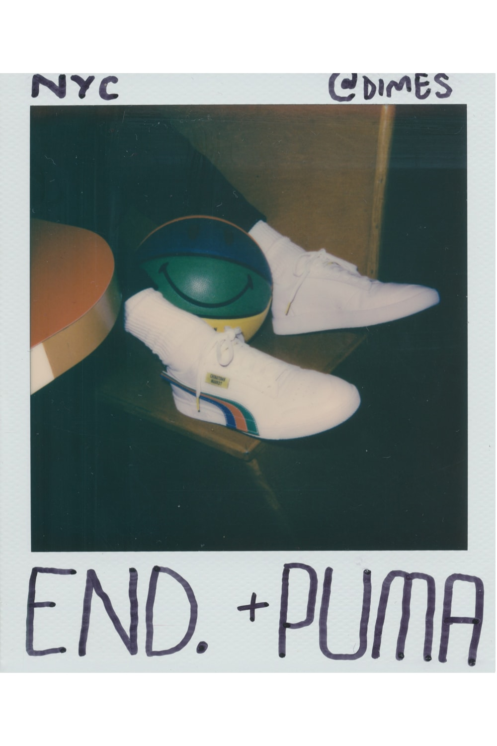 Polaroid of Mike Cherman wearing Puma x Chinatown Market sneaker in Manhattan