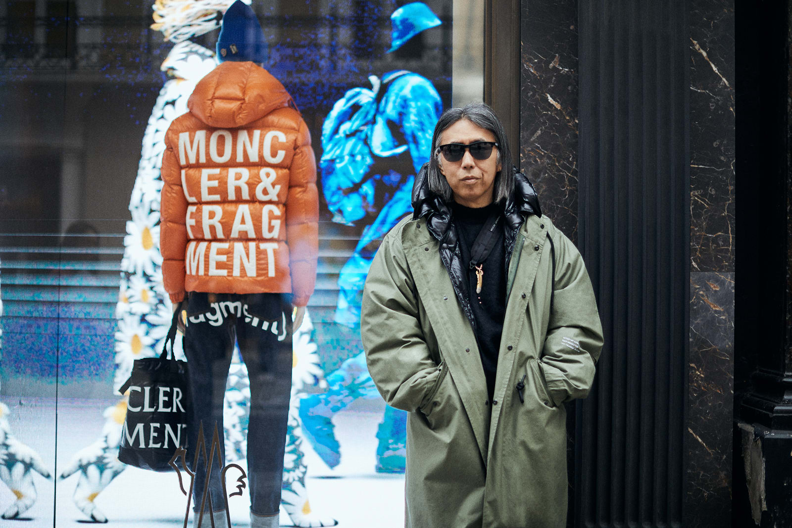 Hiroshi Fujiwara standing outside Moncler store on Bond Street during Moncler Genius World Tour shot by END.