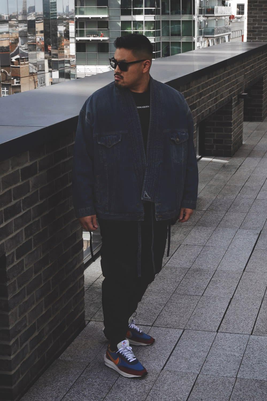 Thierry Tek of Visionarism wearing Nike x Sacai LDWaffle Balenciaga jacket Maharishi pants for END. Style Code: BV0073-400