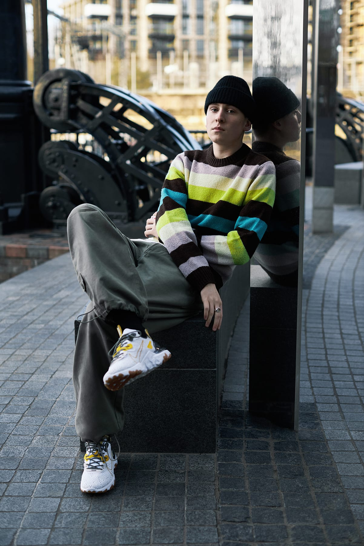 Billy Menezes wearing the Nike React Vision in doing street magic in London