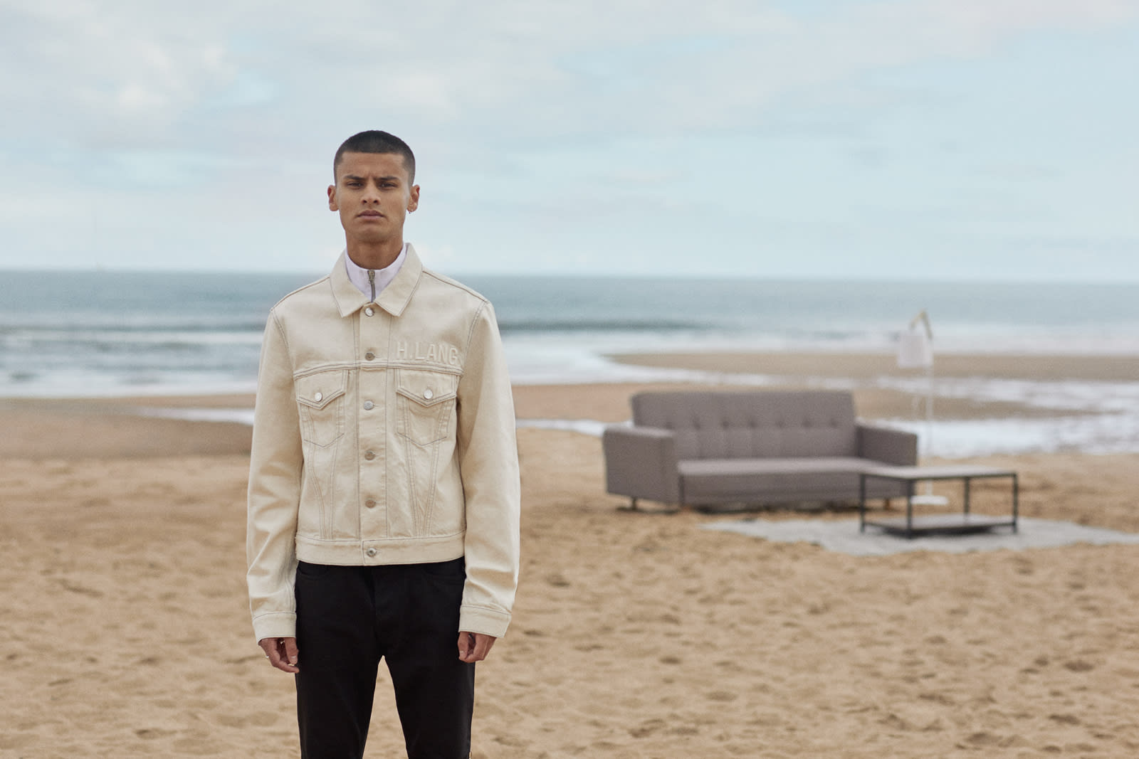 Helmut Lang trucker jacket worn at the beach for Bare Minimum END. editorial