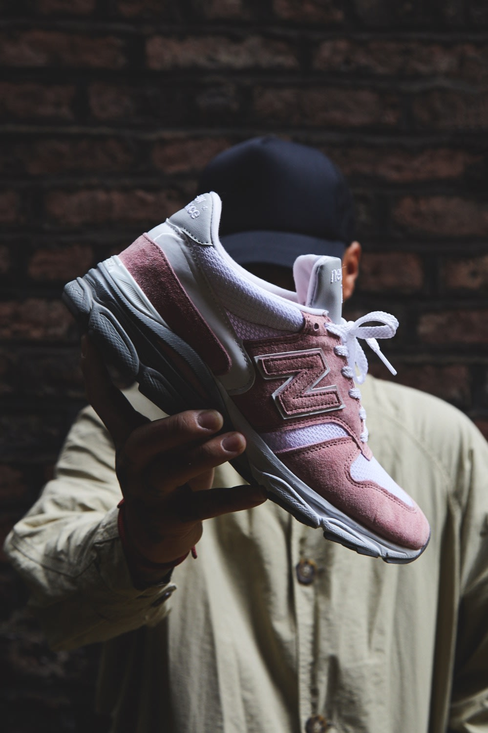 Ste Wing of Visionarism holding pastel pink New Balance 770.9 for END.