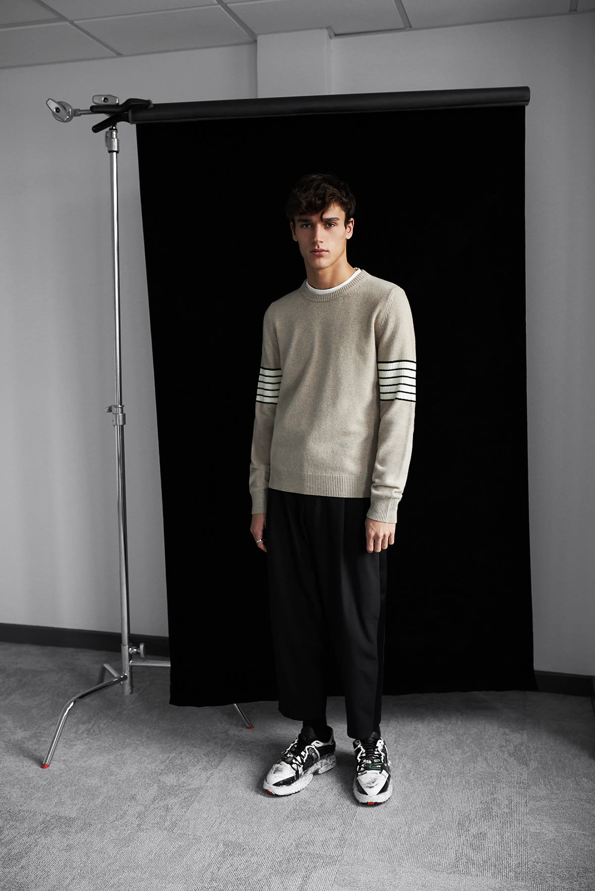 Maison Margiela's refined elegance with the arm stripe crew knit