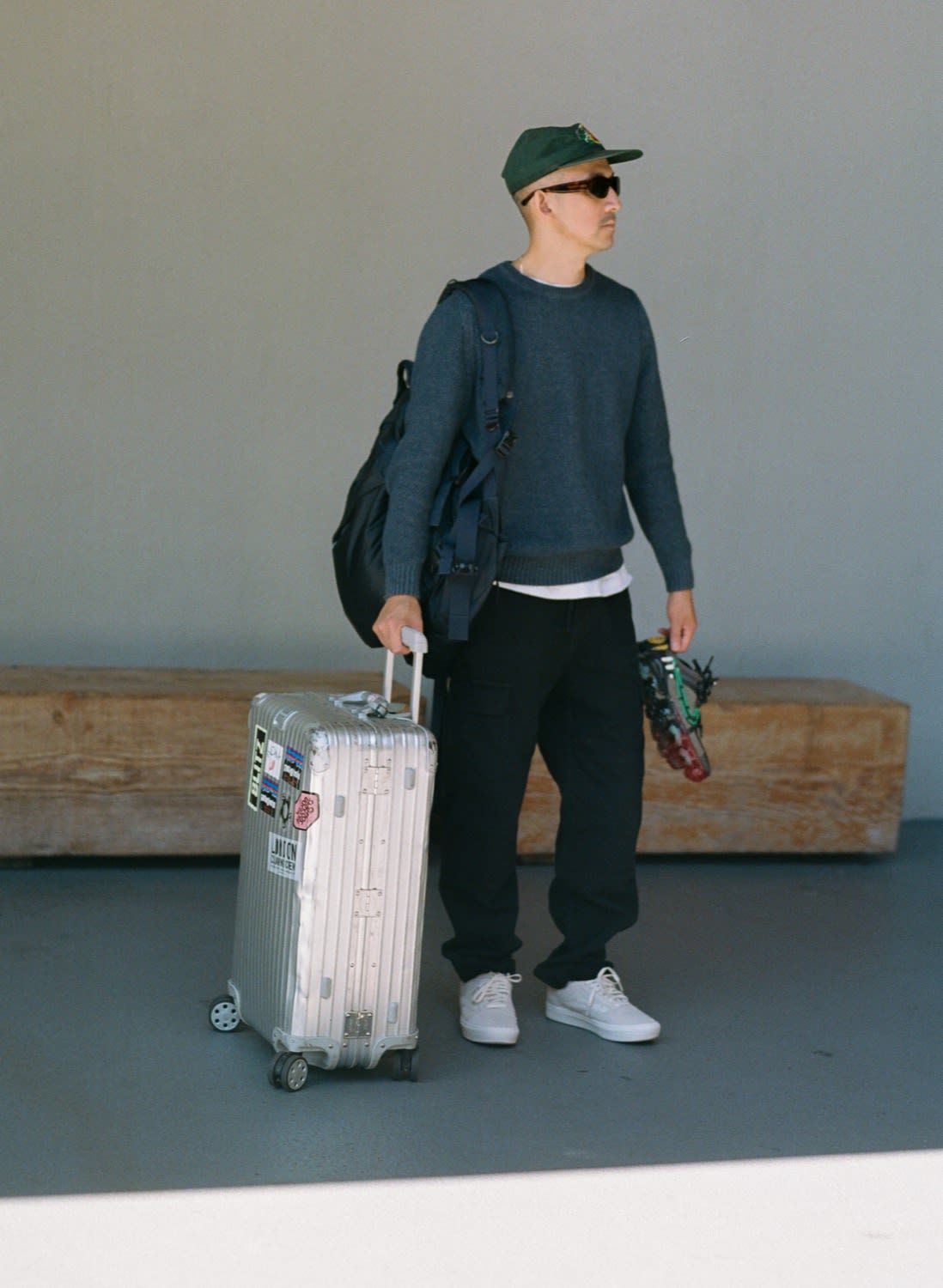 Jason Markk wearing VANS VAULT x Blends Bones Old Skool ComfyCush LX with Rimowa suitcase in LA