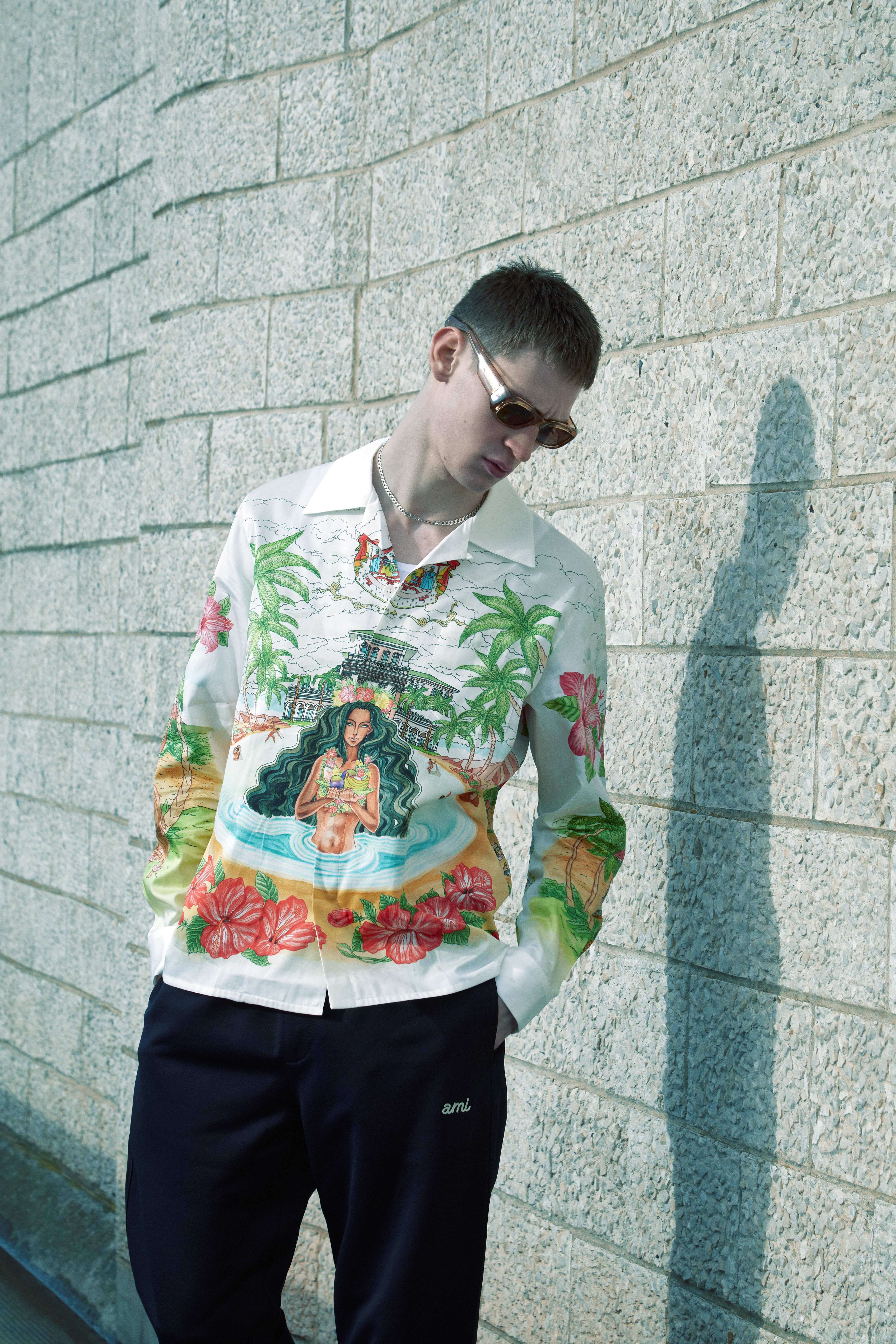 END. Required Item SS21: Track Pants - Model wears AMI Tech Track Pant and Casablanca Printed Shirt