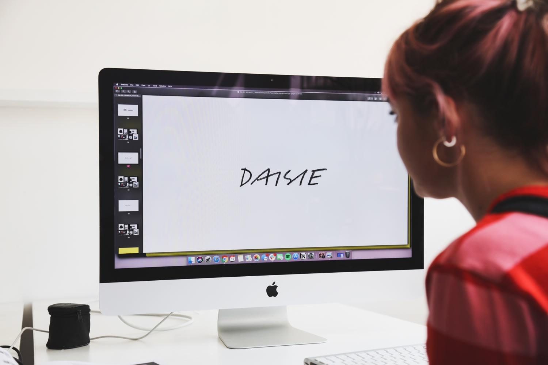 Maisie Williams with her Daisie app branding on screen