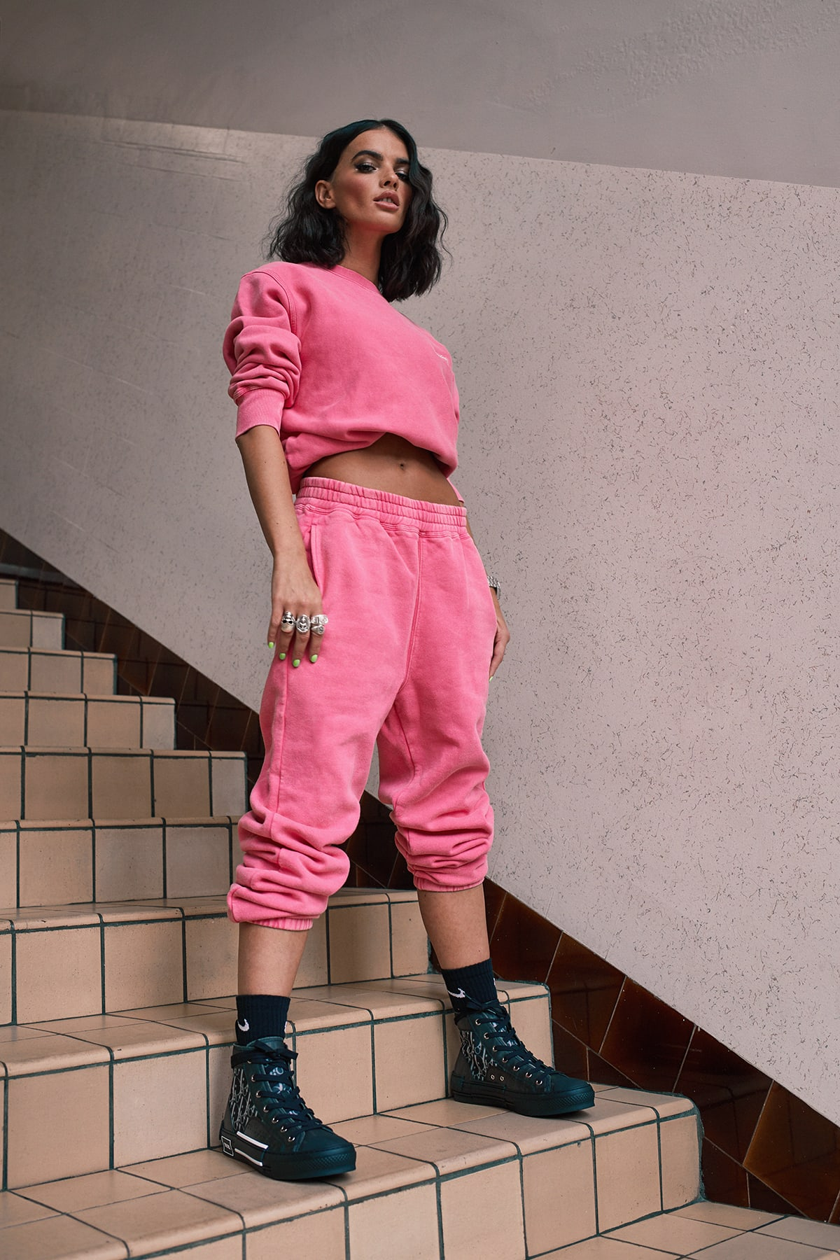 La La wears Stussy Stock Logo Tracksuit and Dior Oblique Sneakers