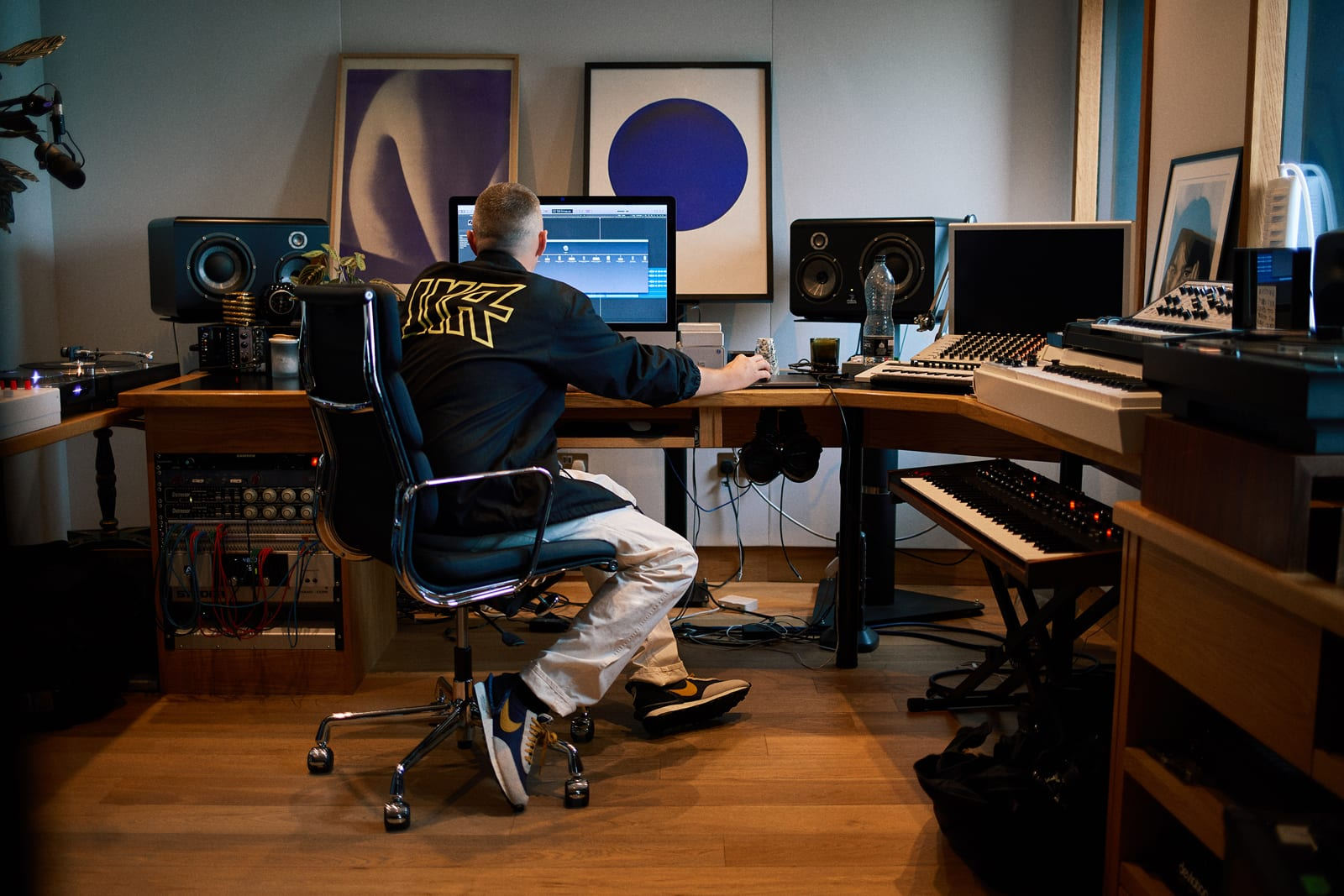 Benji B working in his London studio wearing Luker by Neighborhood and orSlow for END.