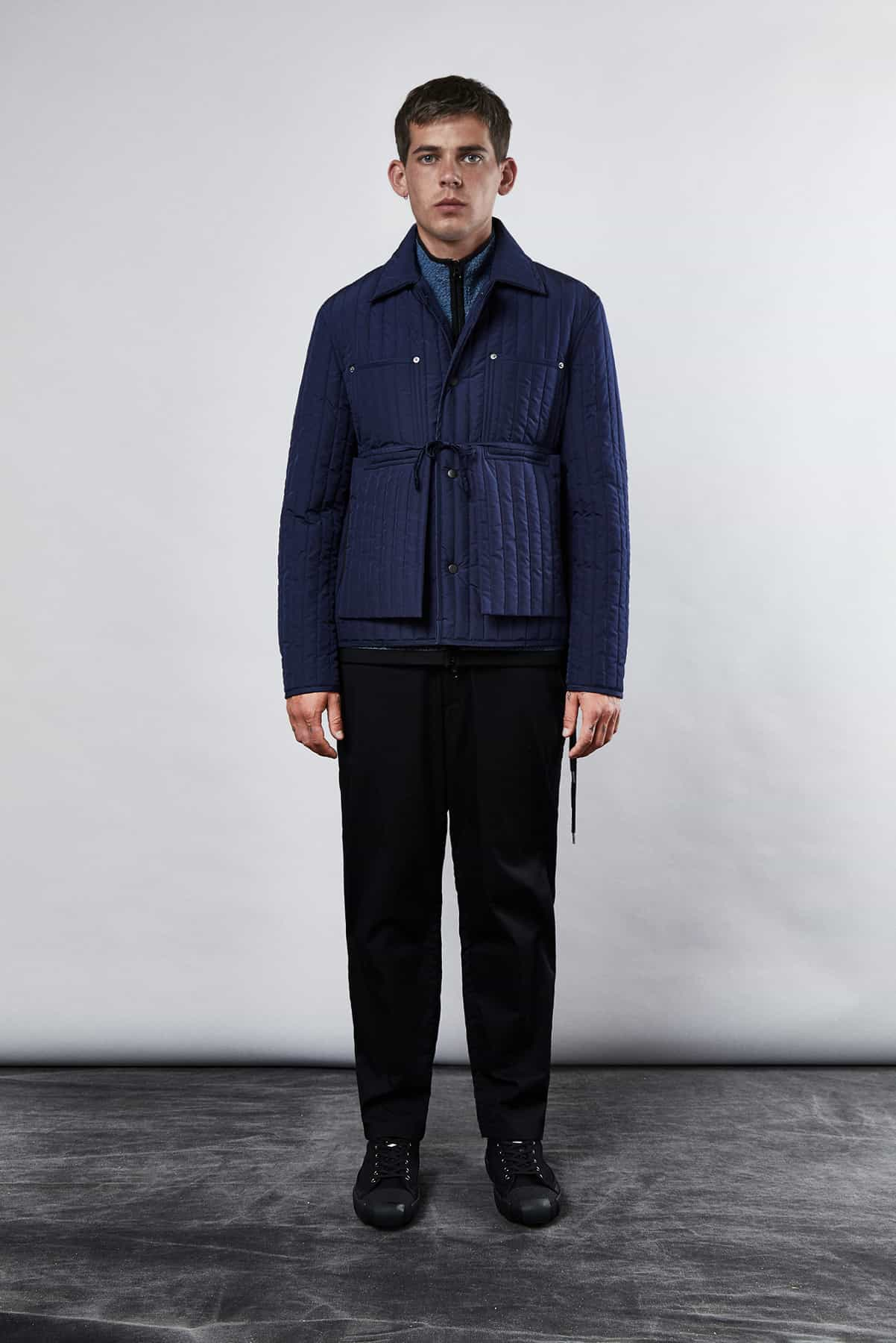 END. Craig Green Core AW19 - Model wears quilted worker jacket in navy