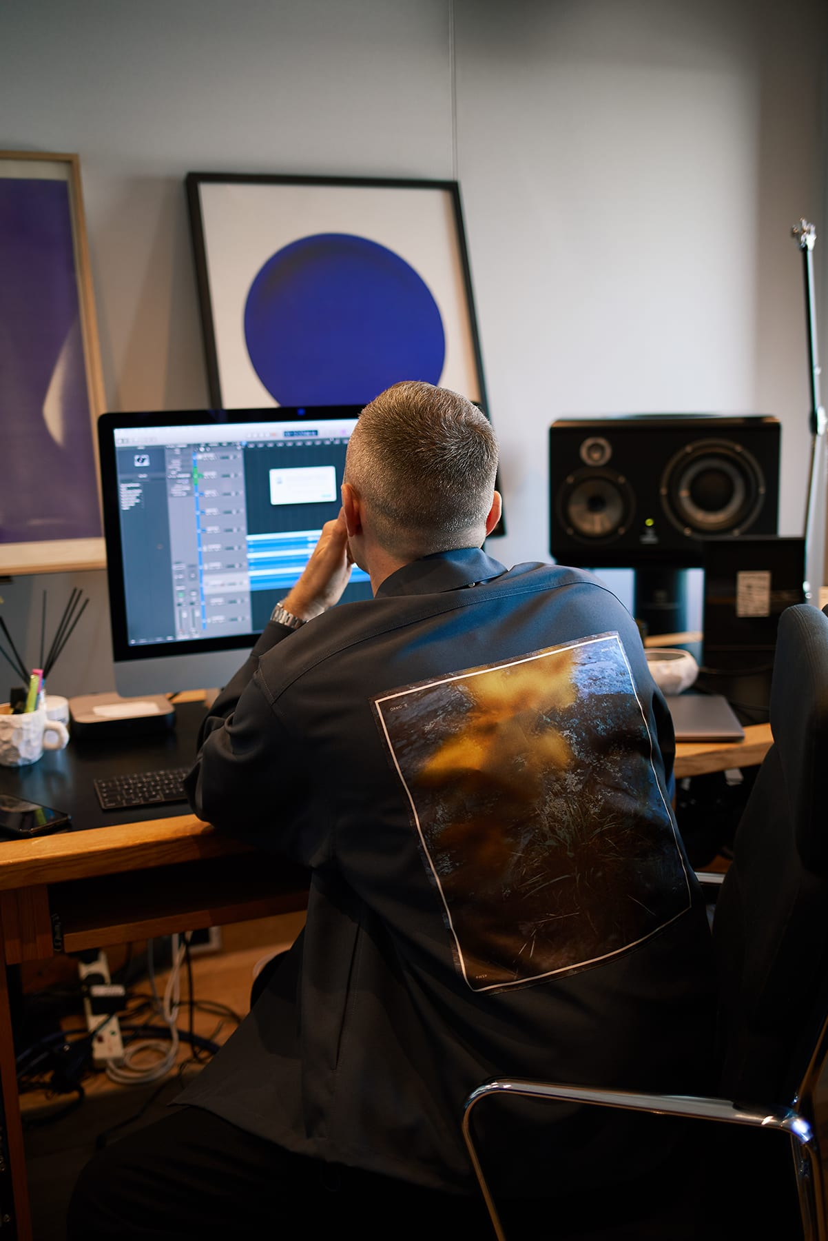Benji B looking through records in his London studio shot by END.
