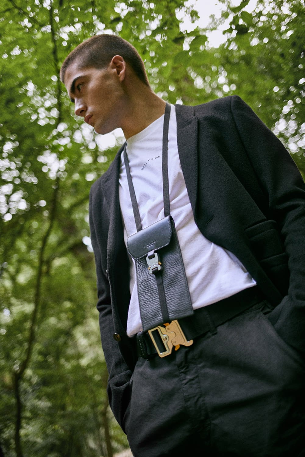 END. AW19 Required Item: Micro Bags model wears 1017 ALYX 9SM Mini Buckle Bag