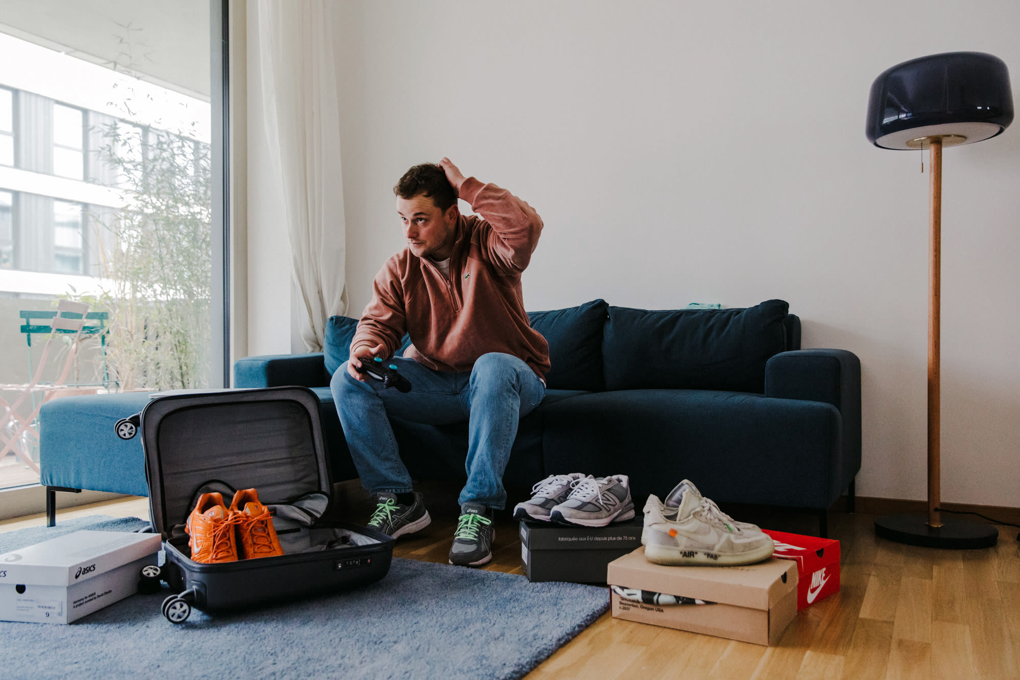 """Flight Case Sneakers: Fabian Gorsler at Home in Berlin, image features Nike Shox TL, Off-White x Nike """"The Ten"""" Air Force 1, New Balance 990v5, and ASICS x Harmony GEL-Venture 6"""