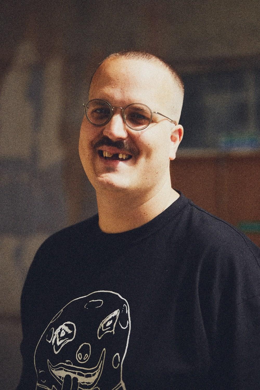Portrait of British menswear designer Liam Hodges at The Silver Building in London