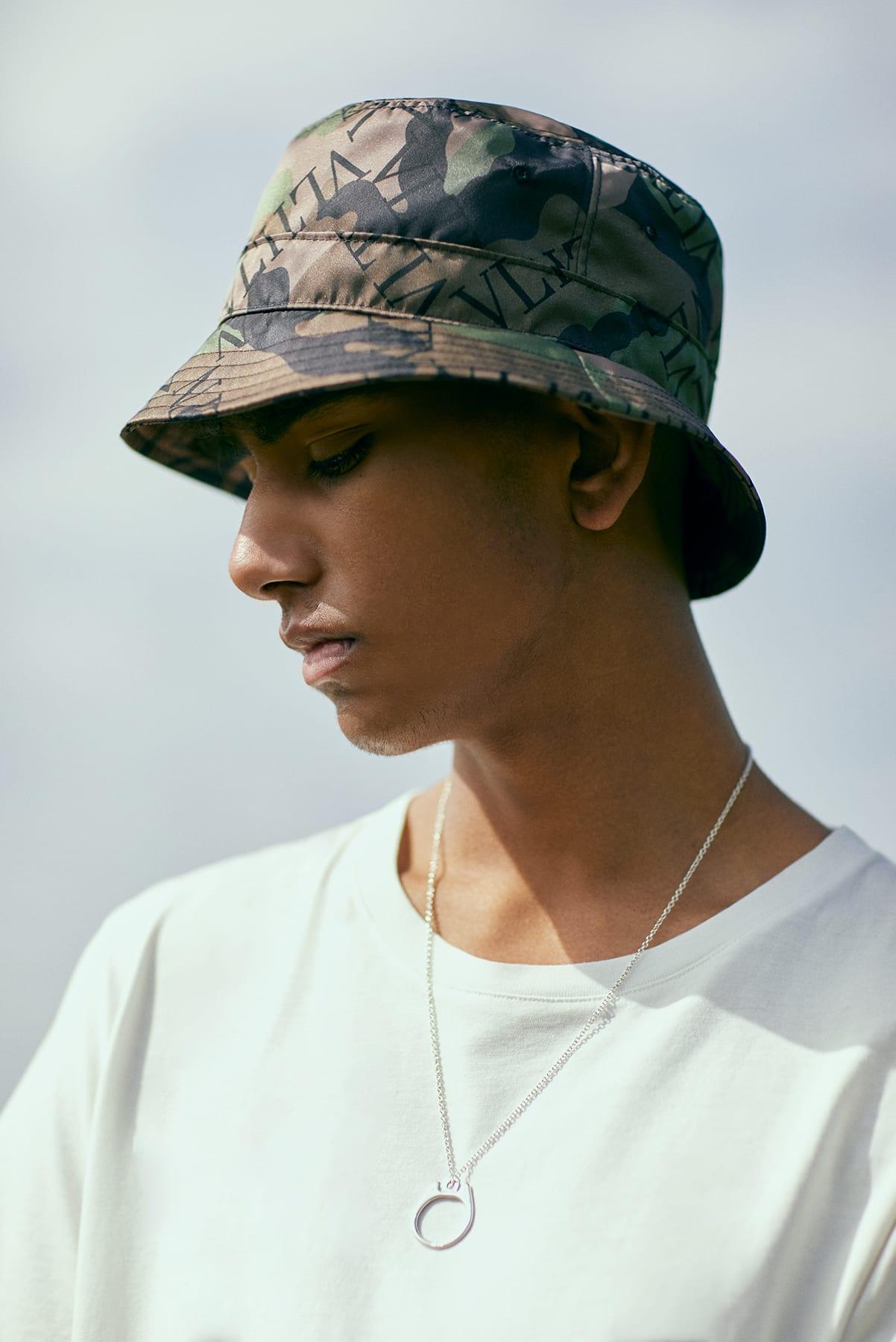 END. Required Item: Bucket Hats - Model Wears Valentino Grid Logo Bucket Hat