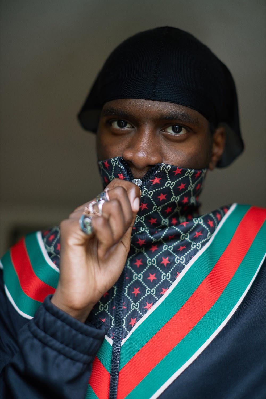 London musician Master Peace wearing Gucci track jacket.