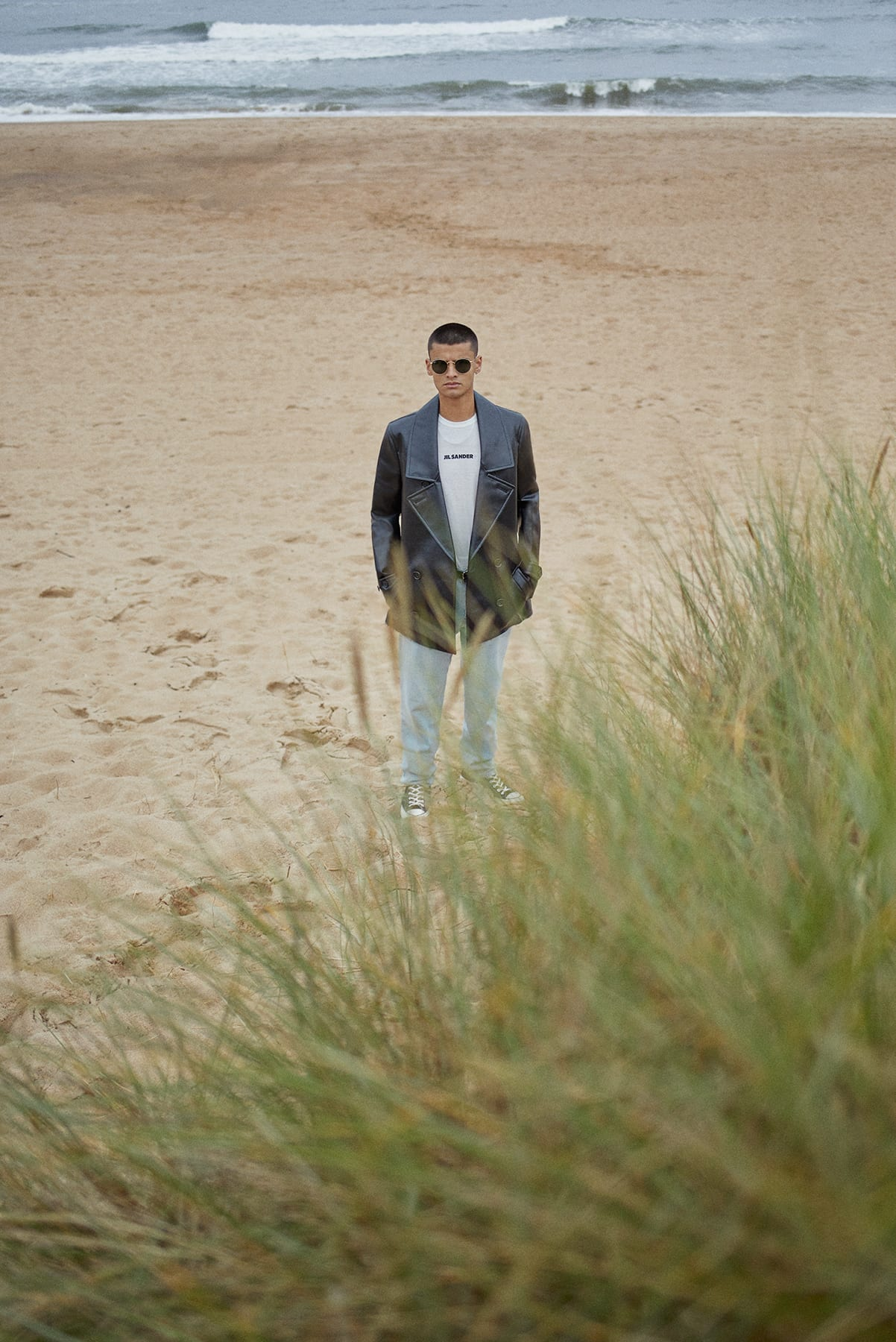 On the dunes with a Comme Des Garçons Homme Plus PVC Peacoat for Bare Minimum END. editorial.