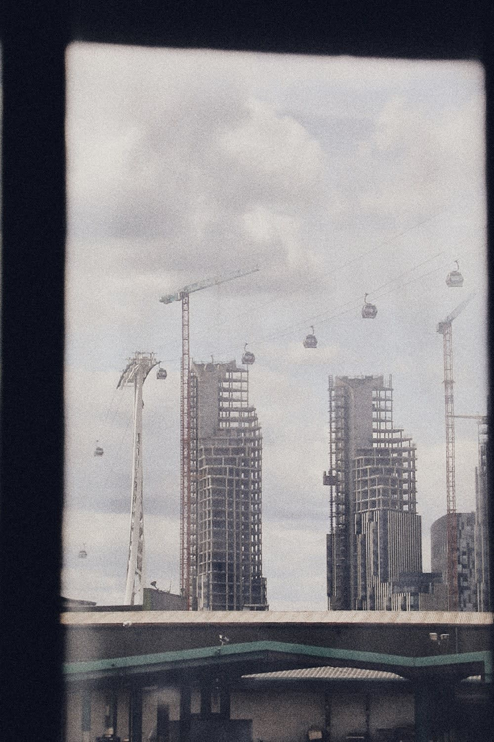 The emirates air line cable cars photographed from The Silver Building