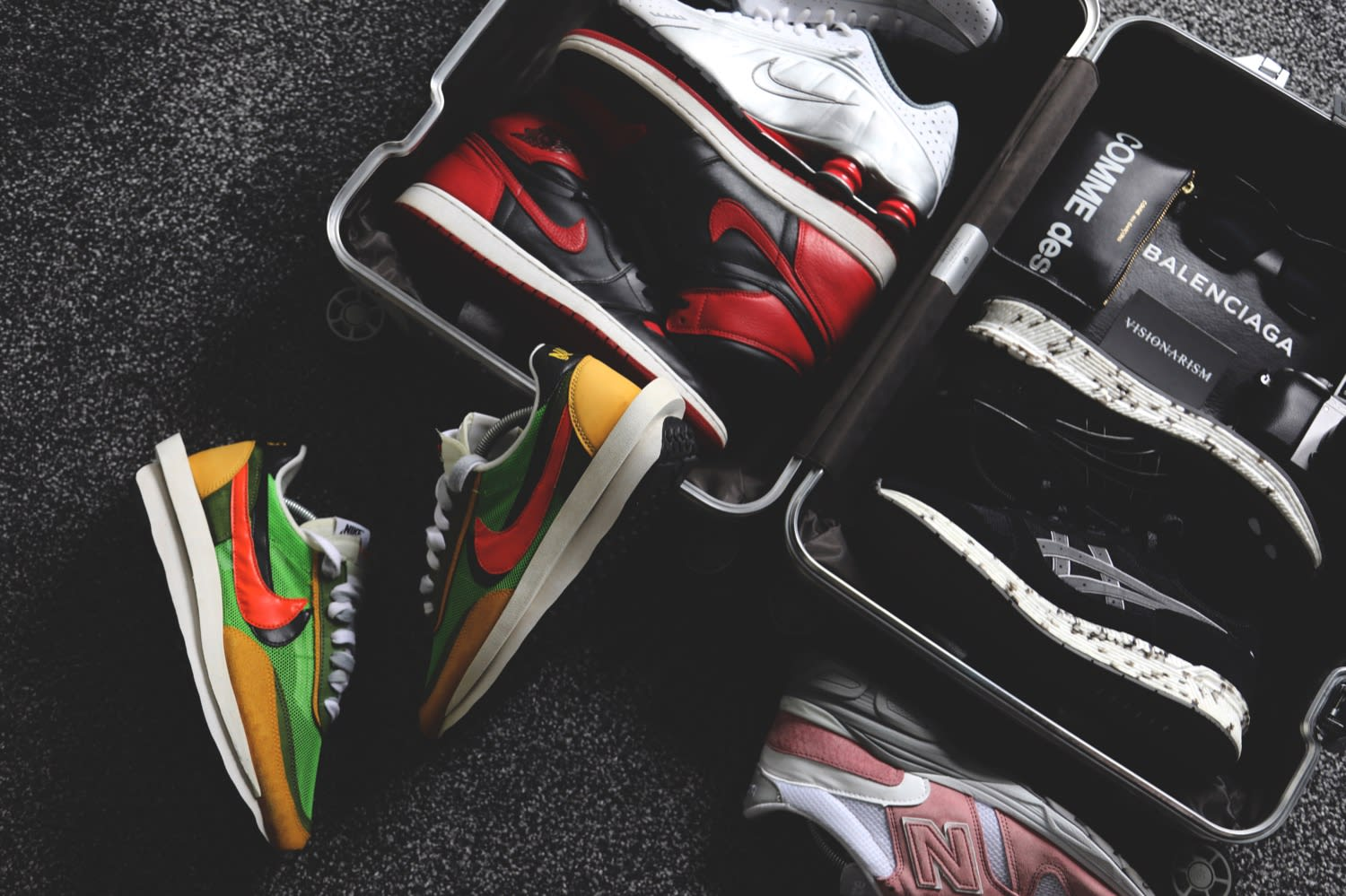 Ste Wing's Rimowa flight case packed with Sacai x Nike LDWaffle, AJ1 Bred, Nike Shox R4, New Balance 770.9, and Visionarism x ASICS TIGER HyperGEL-LYTE