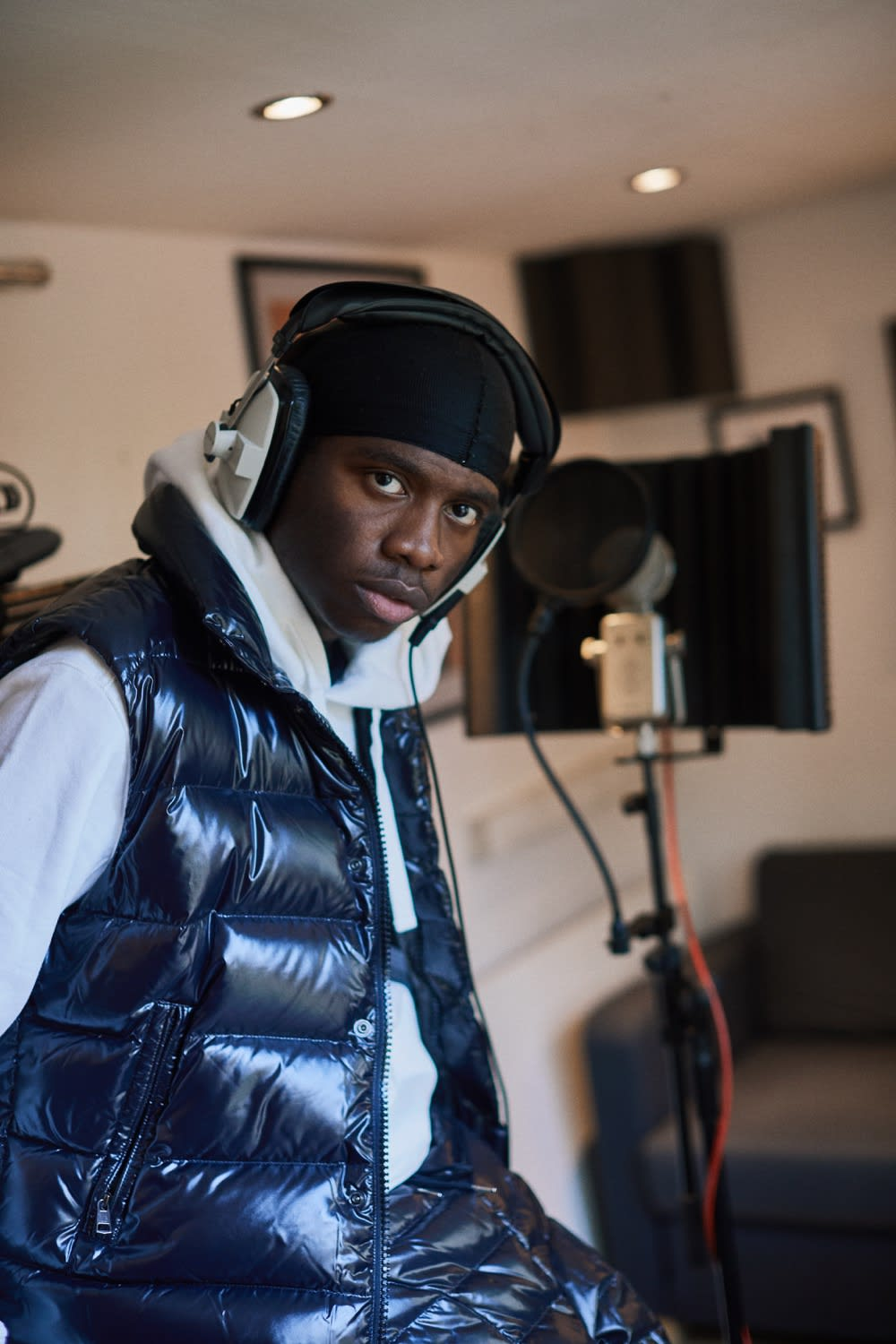London musician Master Peace recording vocals at his home studio.