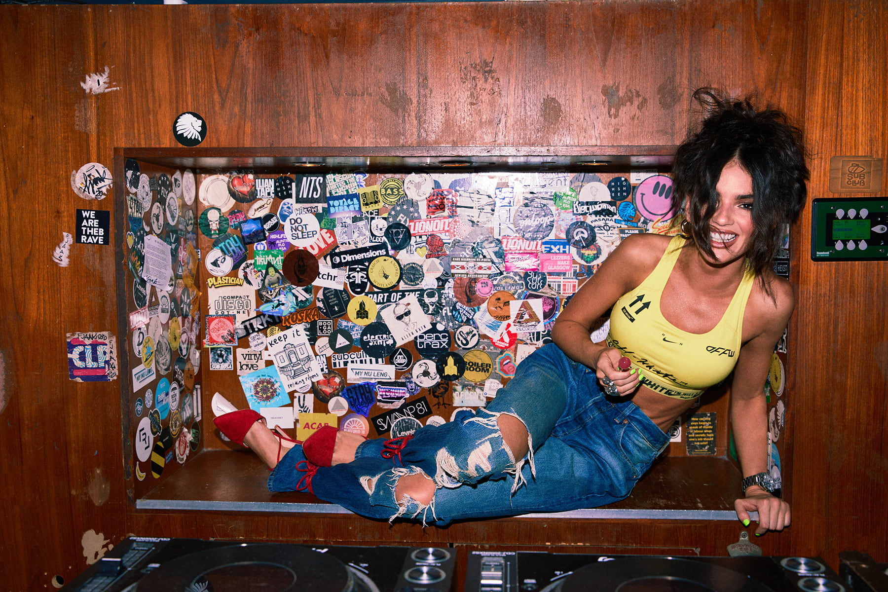 La La shot in Sub Club wearing Nike x Off-White NRG Bra and Levi's 501 jeans