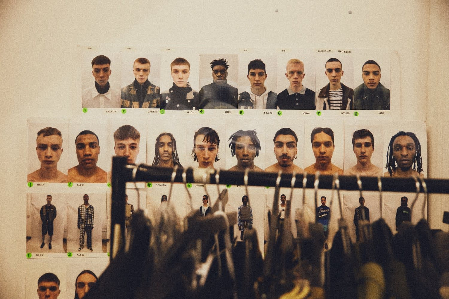 A wall of polaroid shots of the models cast for Liam Hodges' upcoming fashion show