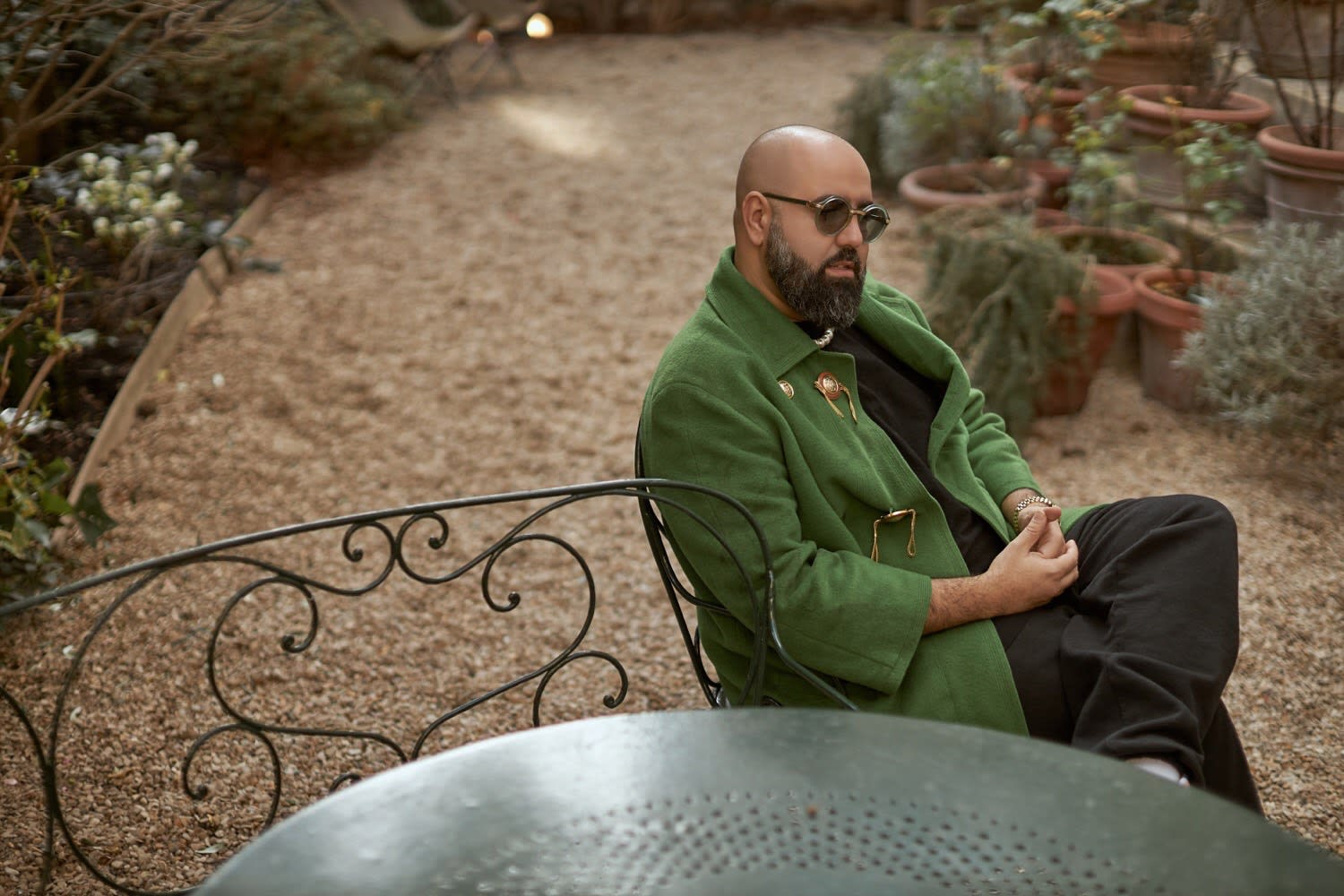 Charaf Tajer relaxing in the garden of the Casablanca showroom following their AW20 presentation