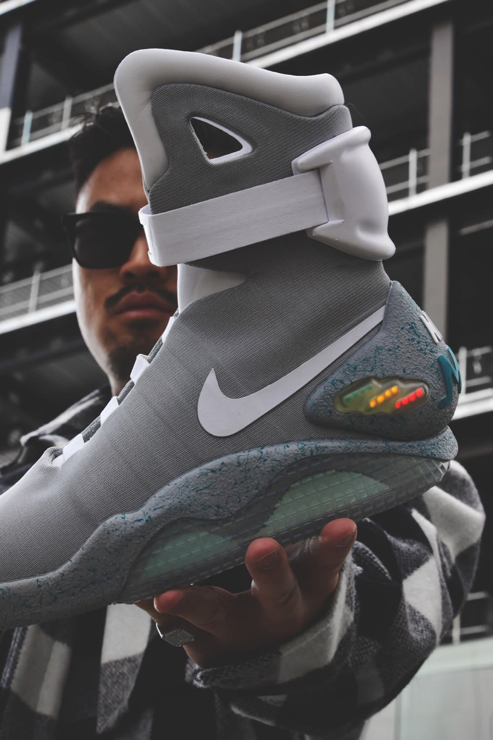 Thierry Tek of Visionarism holding Nike Mag Back To The Future 2016 Style Code: H015-MNOTHR-402