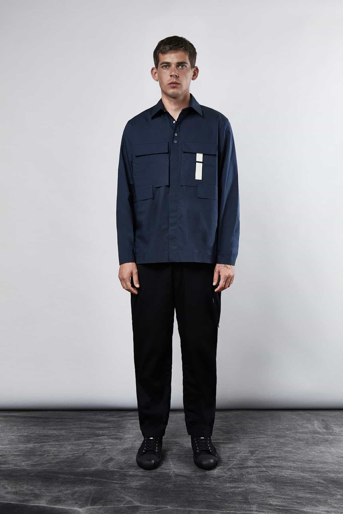 END. Craig Green Core AW19 - Model Wears Ripstop Shirt in Navy