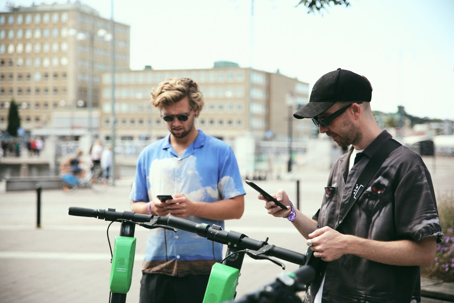 Max Svardh and Albin Johansson of Axel Arigato booking out Lime Scooters in Gothenburg - Axel Arigato City Guide Gothenburg