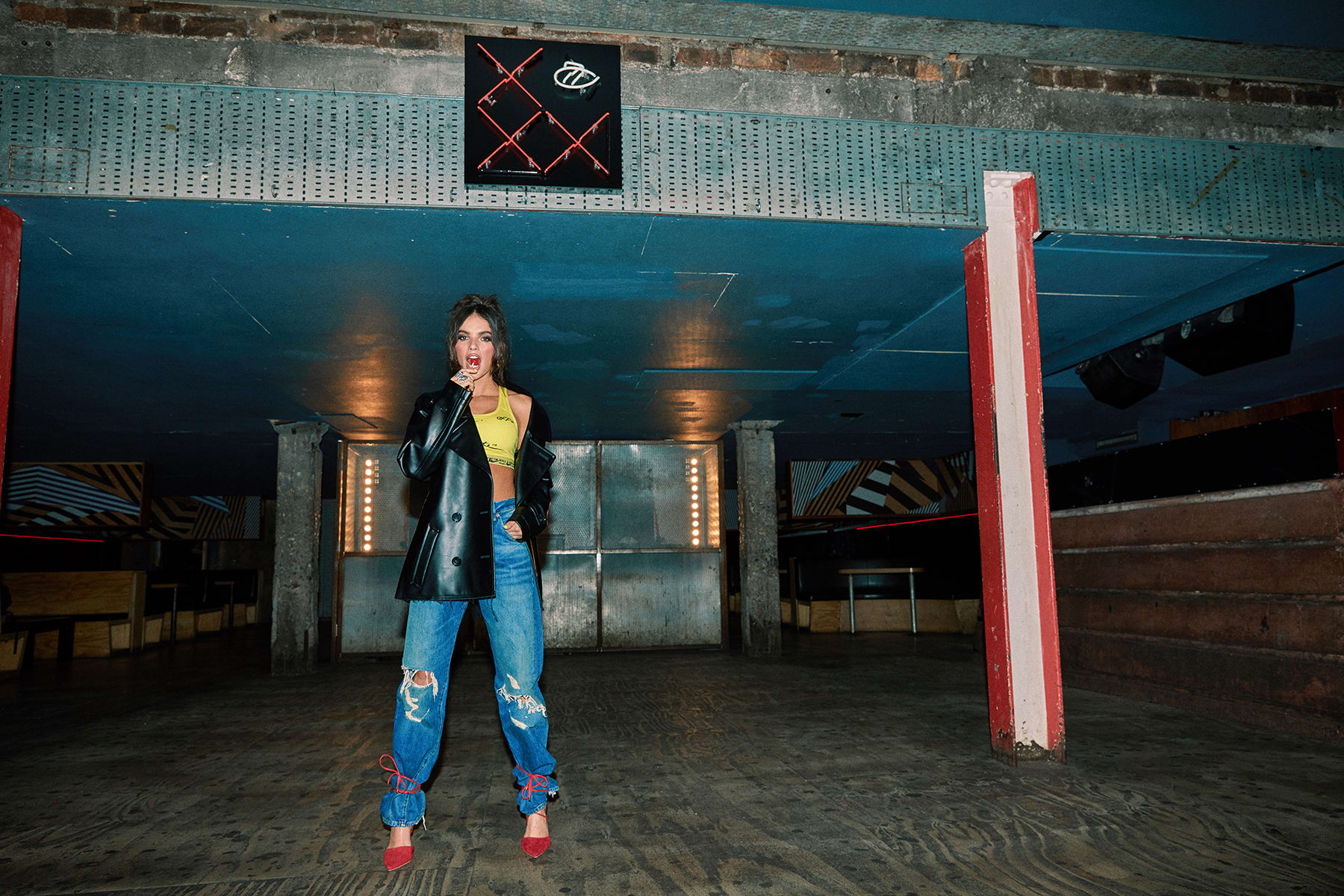 La La wears COMME DES GARCONS PVC Peacoat, Nike x Off-White NRG Bra and LEVI'S VINTAGE CLOTHING 1955 501 Jeans