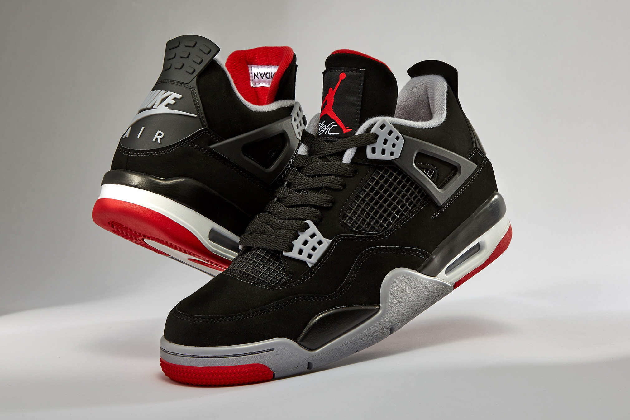 wholesale dealer a90b3 52383 A retro classic direct from the archives, Nike s Jumpman brand reissues the  iconic  Bred  rendition of the Air Jordan 4 with  Nike Air  detailing on  the ...
