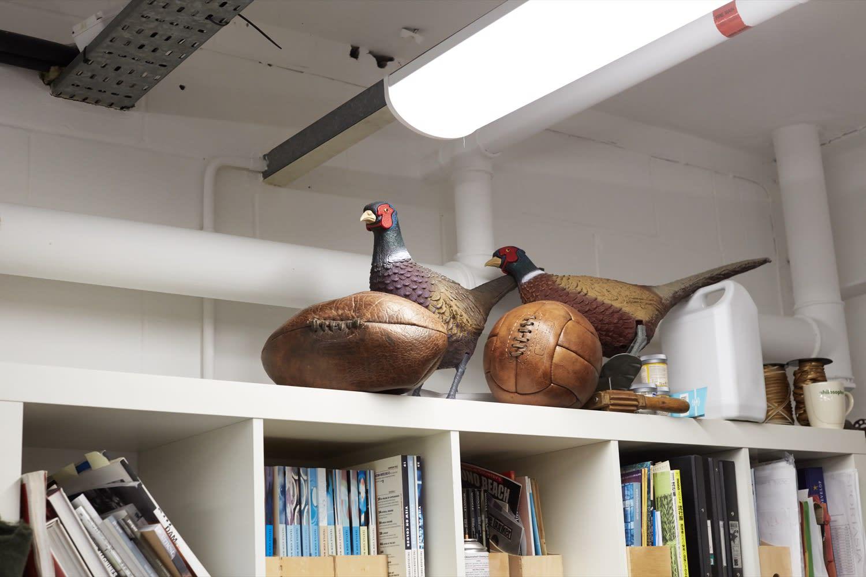 Statues of pheasants in Barbour's design studio