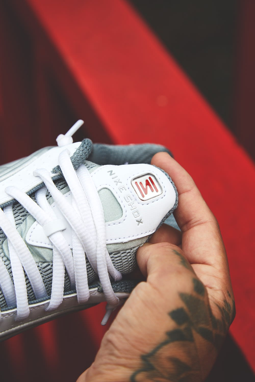 Detail shot of Nike Shox R4 in Metallic Silver by END.