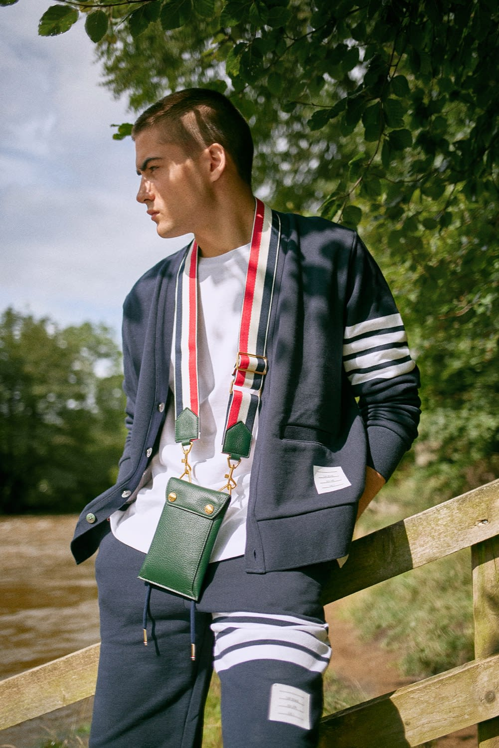 END. AW19 Required Item: Micro Bags model wears Thom Browne Leather Phone Holder Bag with Grosgrain Strap for END.