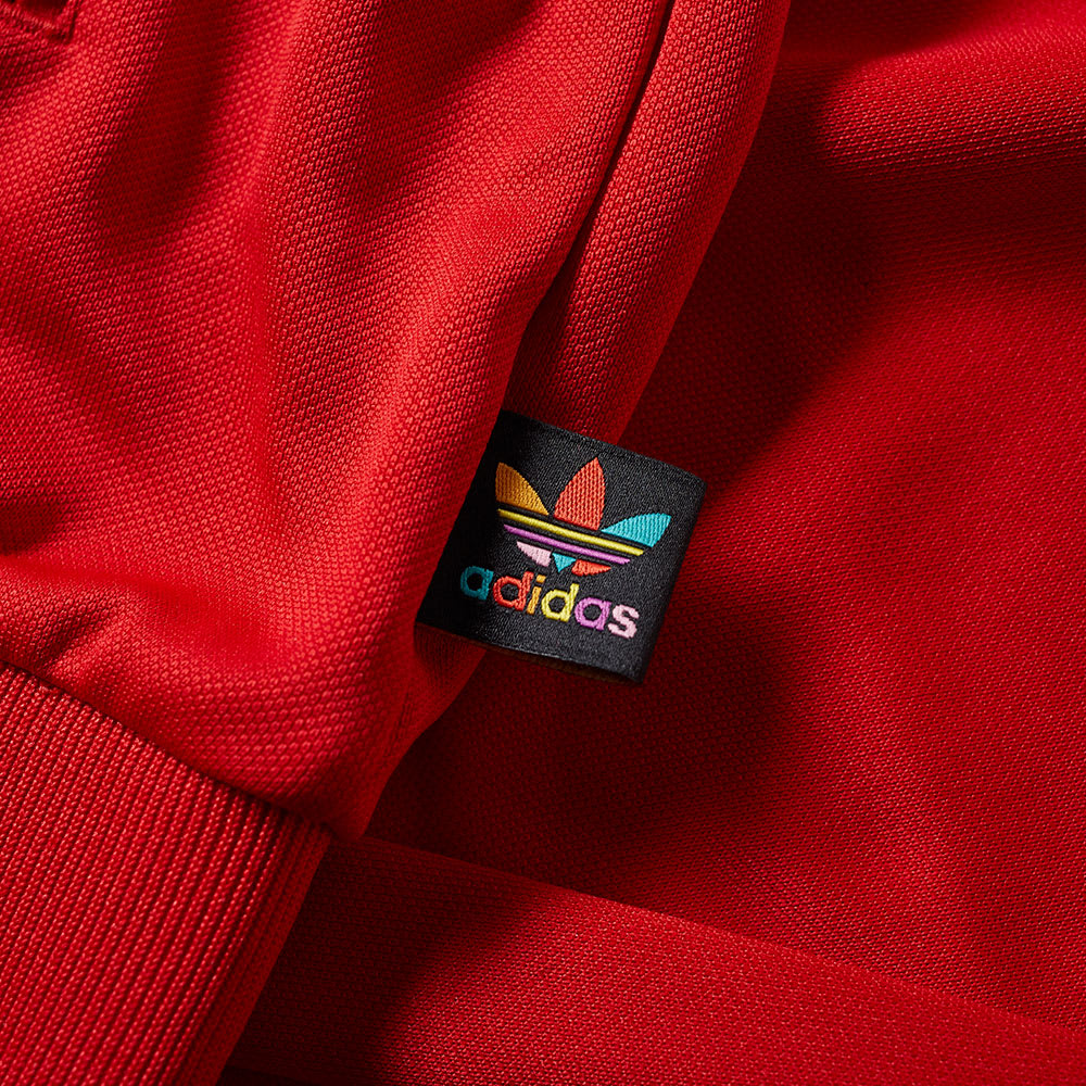 23c37f70d Adidas x Pharrell Williams Human Race Track Top Red   White