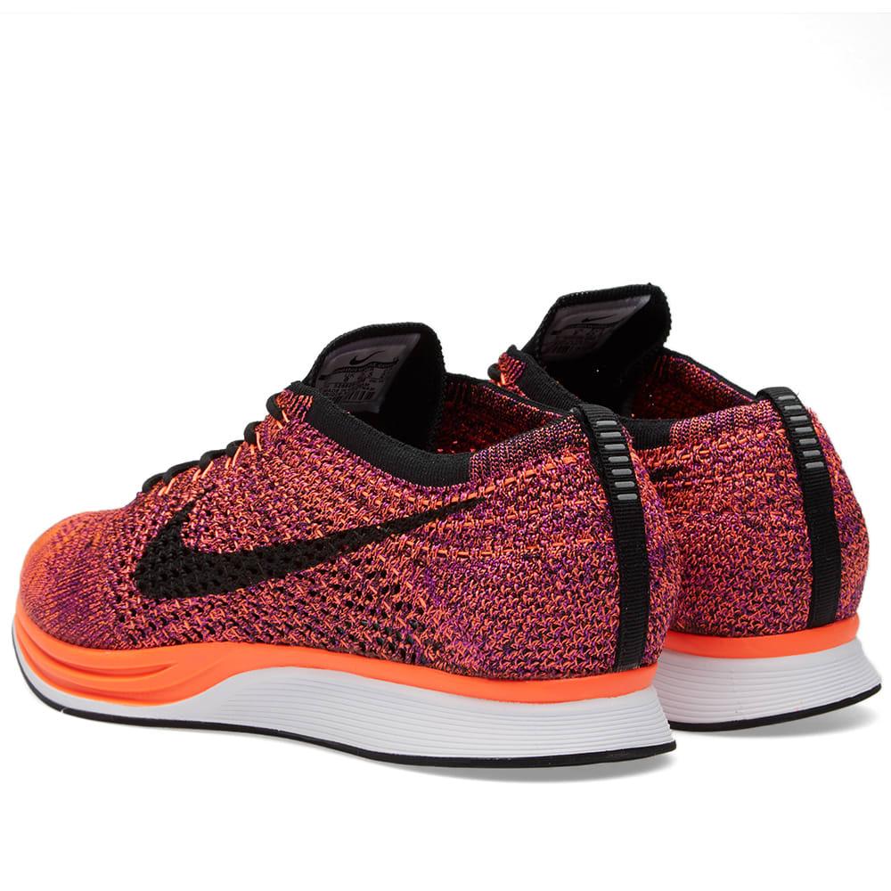 7b32a499d8384 Nike Flyknit Racer Black   Hyper Orange