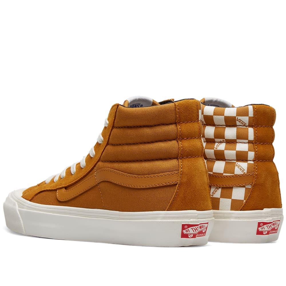 checkerboard vans brown