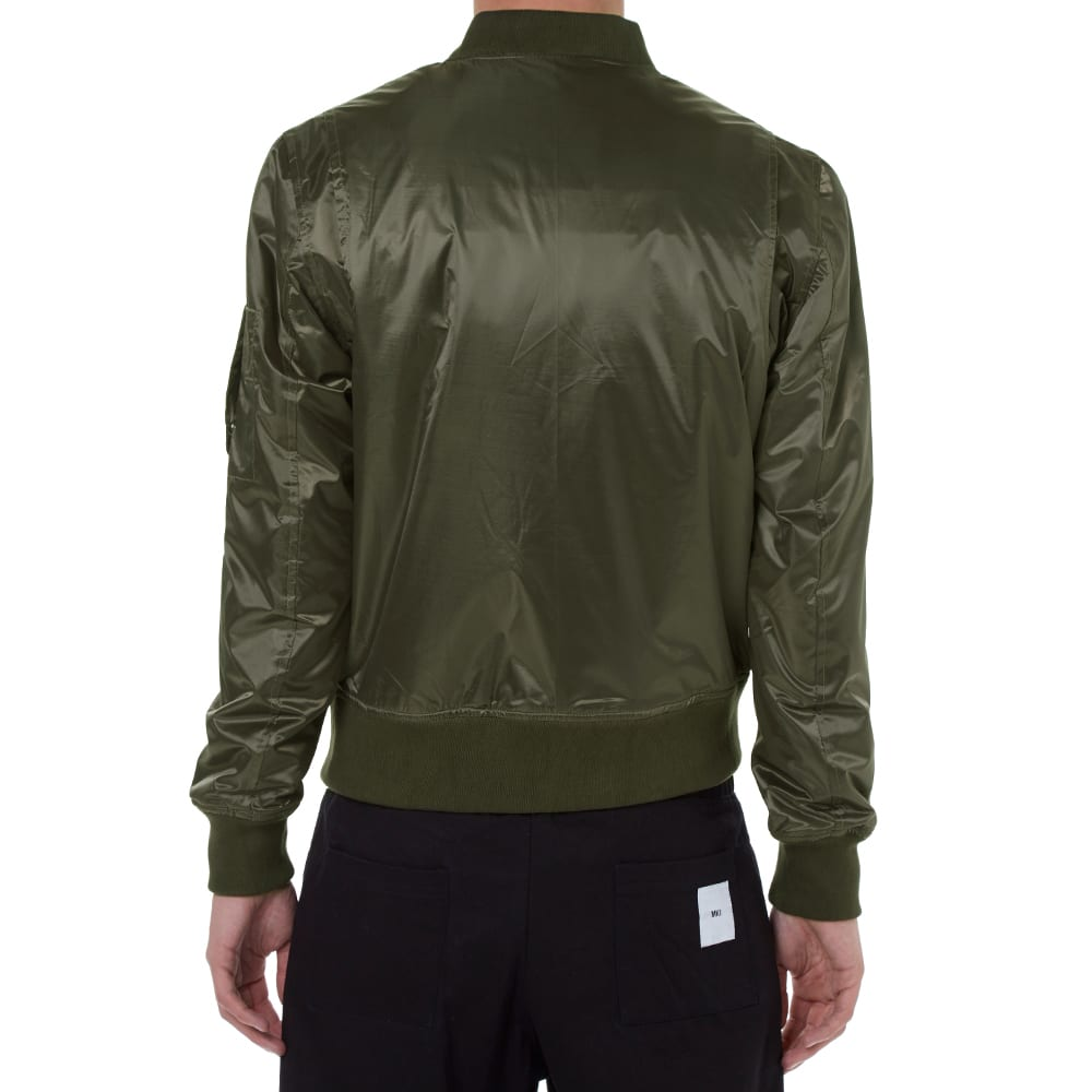 A modern nylon MA-1 bomber jacket. A flight jacket is a casual jacket that was originally created for pilots and eventually became part of popular culture and apparel. It has evolved into various styles and silhouettes including the 'letterman' jacket and the fashionable 'bomber' jacket that is known today.