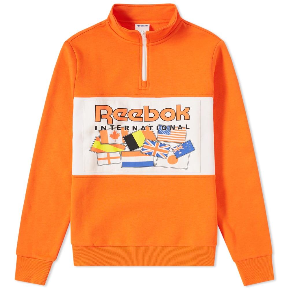 Reebok 1 4 Zip Flag Track Top In Orange  9e019174e8416