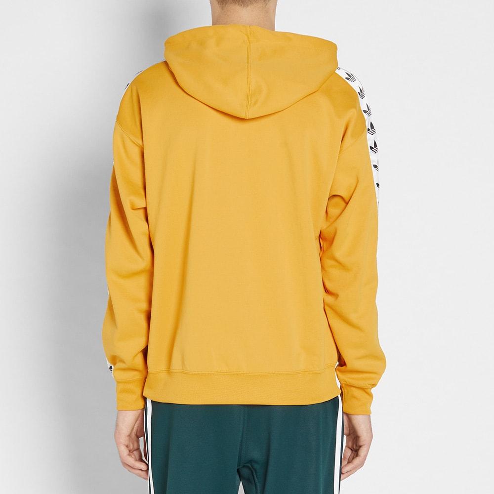 seriamente Araña calendario  Adidas TNT Tape Hoody Tactile Yellow | END.