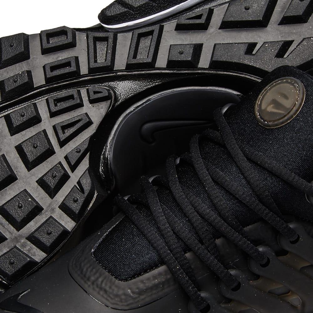 730a587de3 Nike Air Presto Low Utility. Black & White
