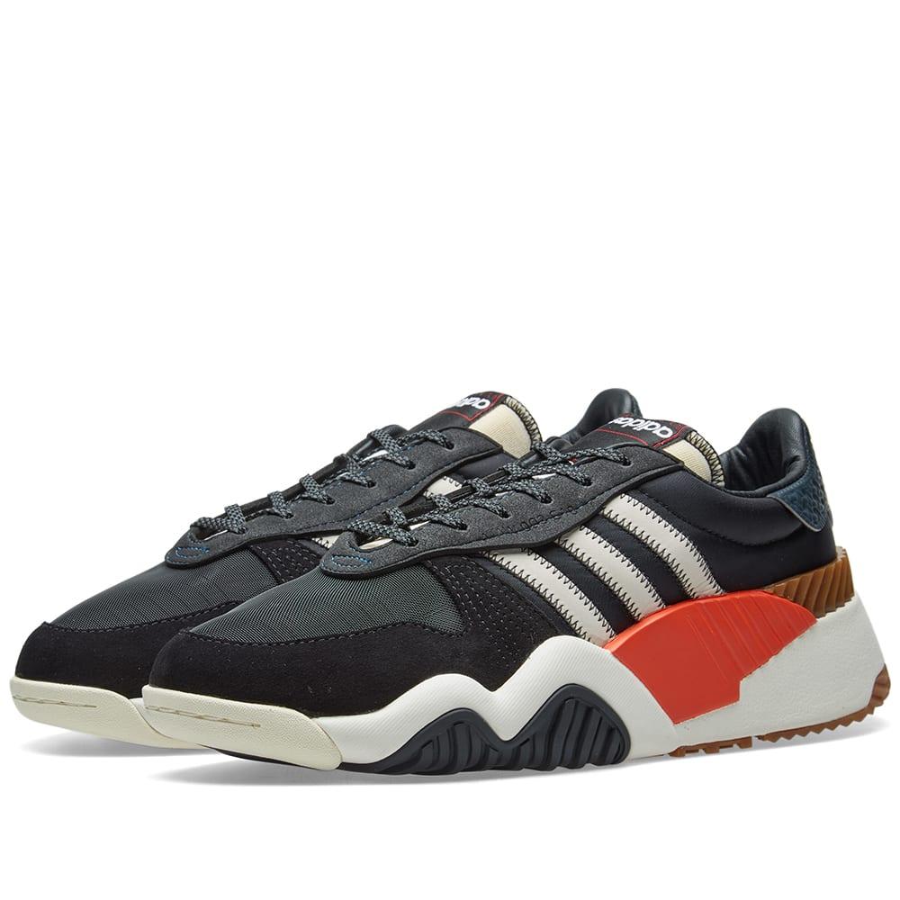 orange and black adidas trainers