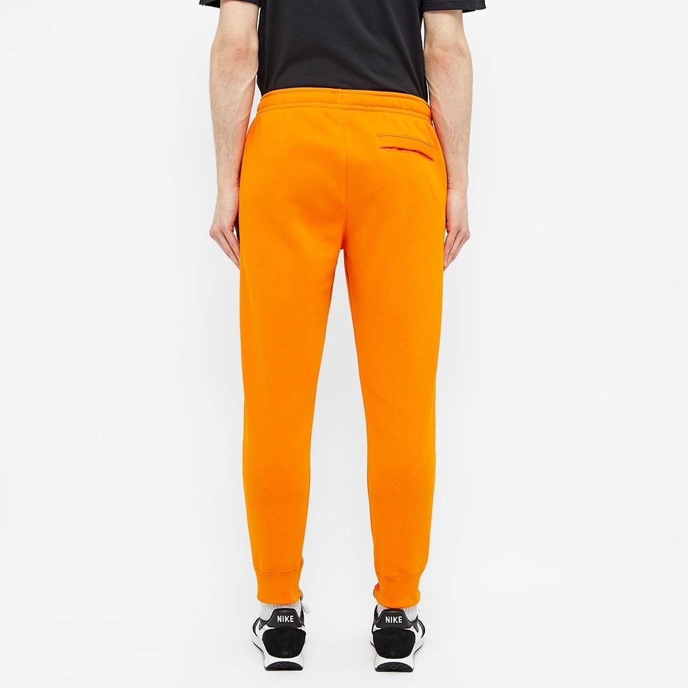 jogging orange nike