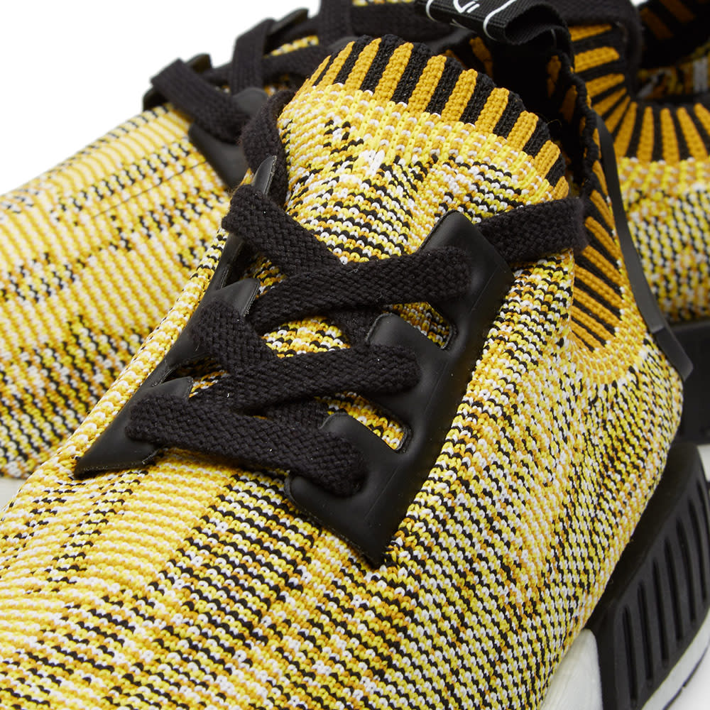 fe74059b35252 Adidas NMD Runner PrimeKnit Core Black   Nomad Yellow