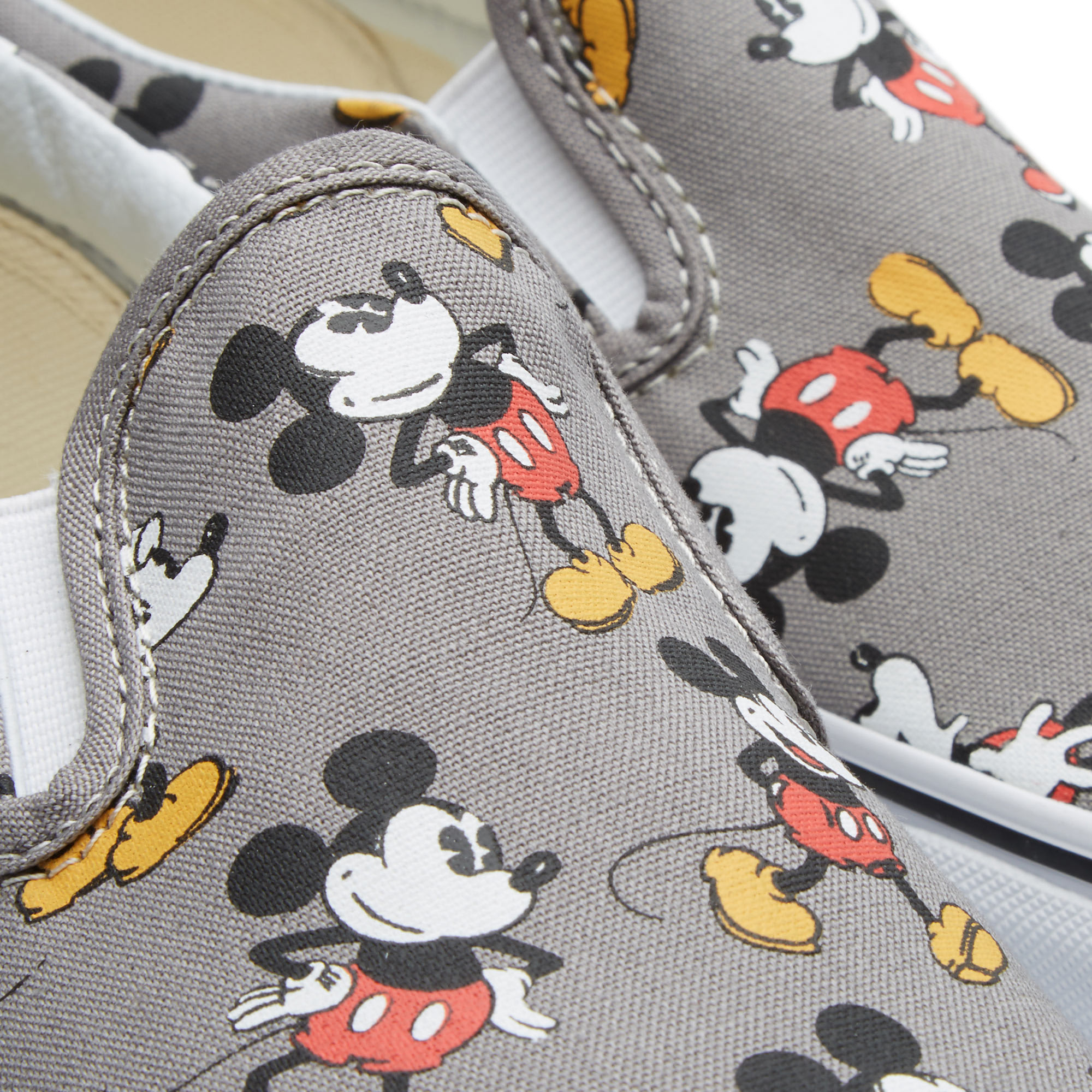 4d2db12b44200d Vans x Disney Classic Slip On Mickey Mouse   Frost Grey