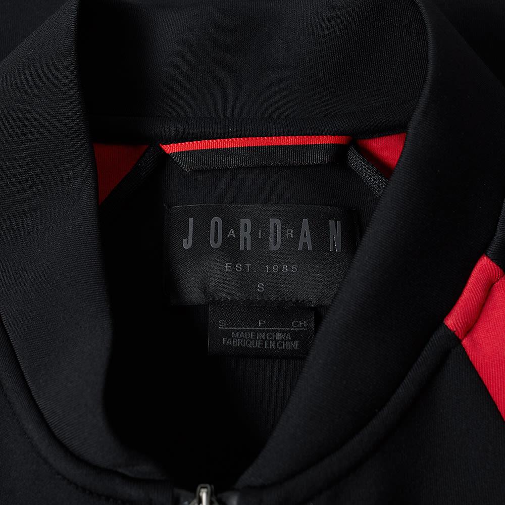 507a09a0f8f7fd Nike Jordan Flight Tech Jacket Black   Gym Red