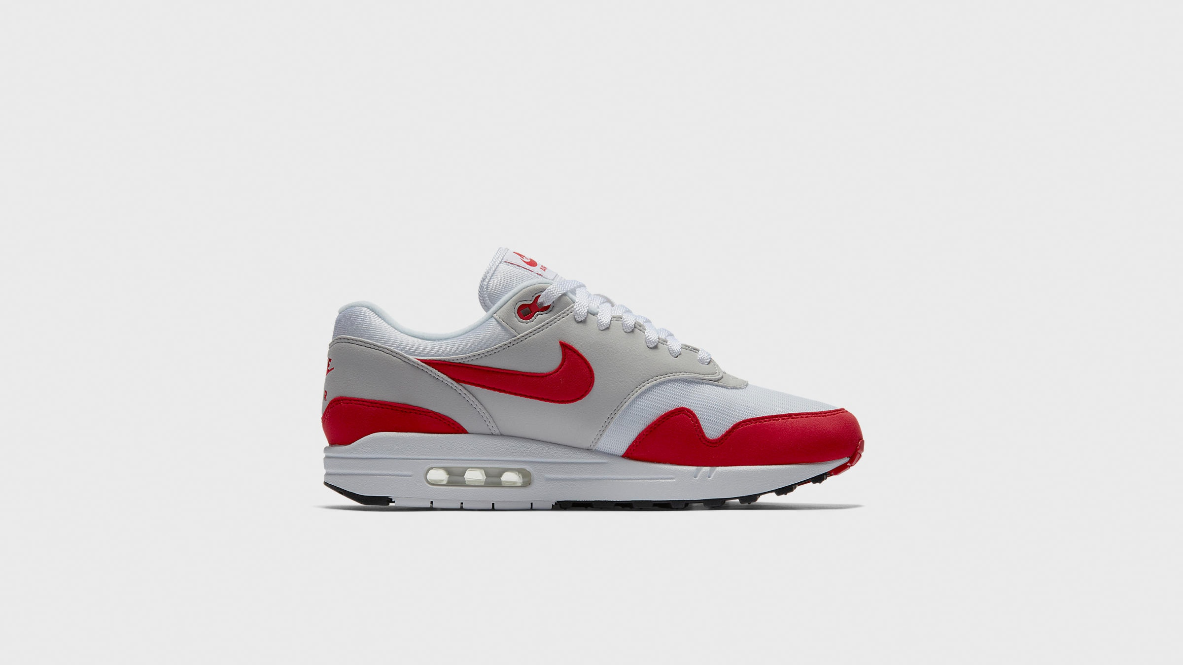 hot sale online 637b8 cb572 Nike Air Max 1 Anniversary White   University Red   END.