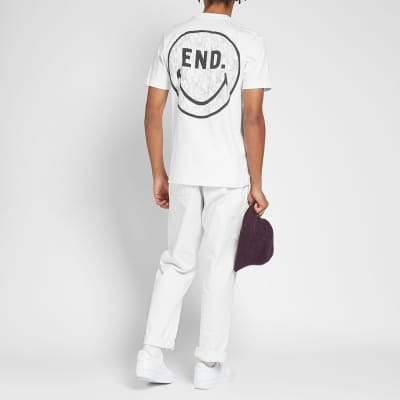 END. x Chinatown Market Smiley Face Tee