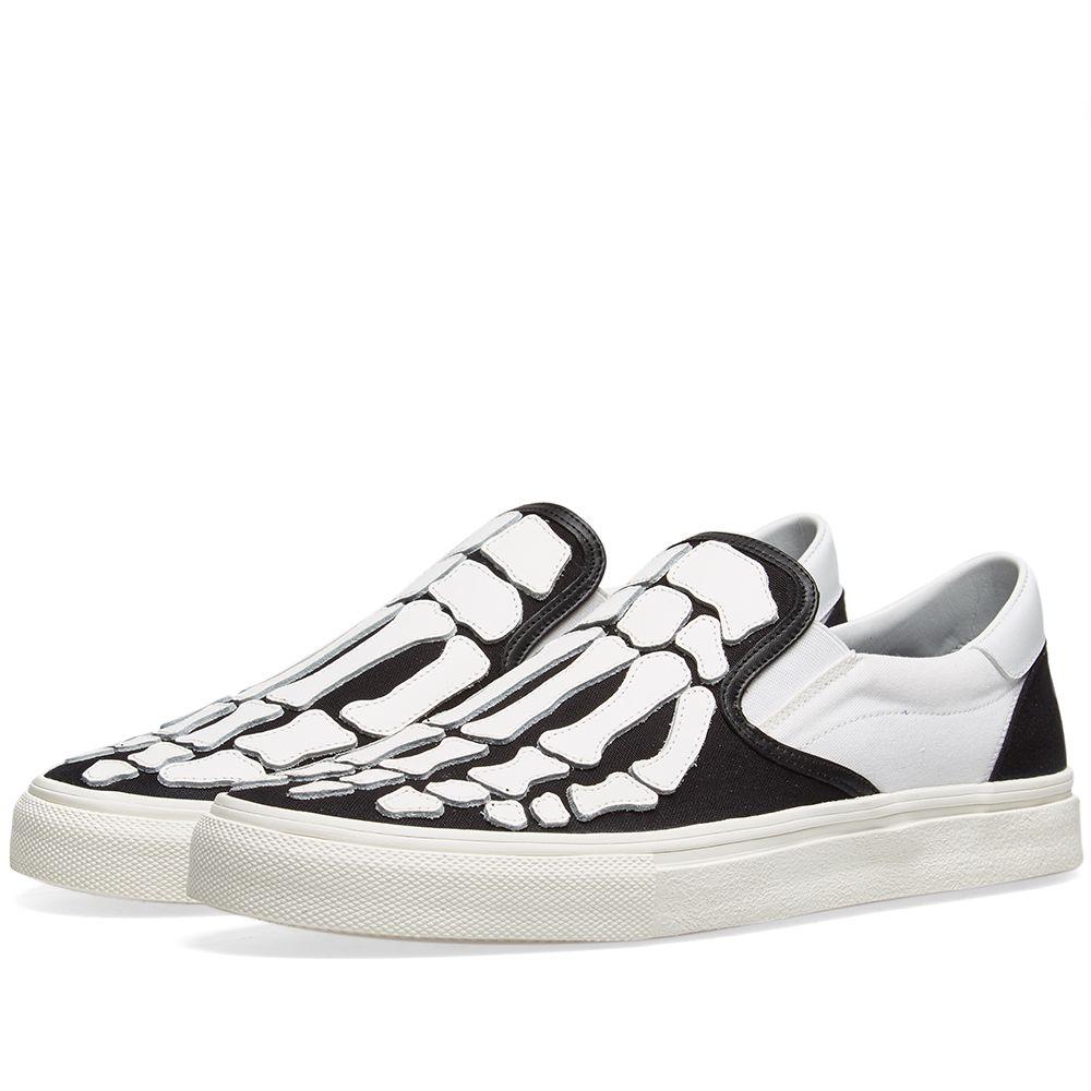 29f69b55c7bb AMIRI Slip On Bones Sneaker Black   White