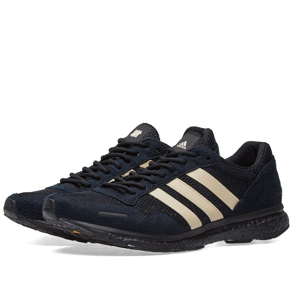 huge selection of 593a9 3102e homeAdidas x Undefeated Adizero Adios 3. image. image. image. image. image.  image. image. image